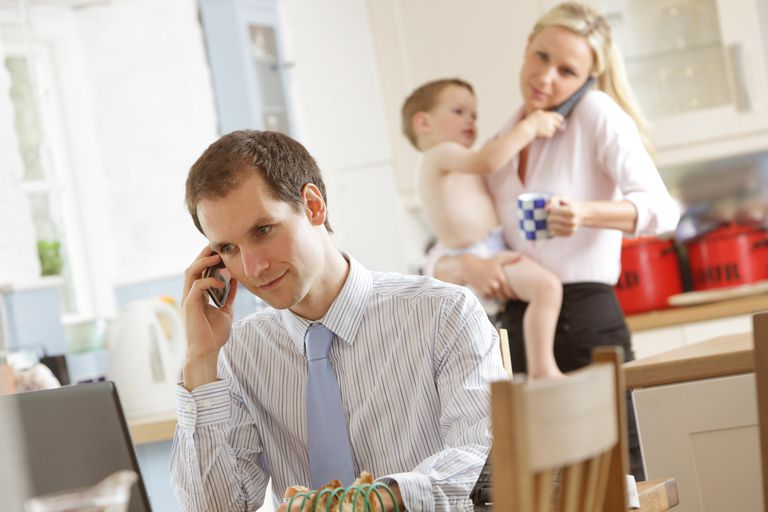 Working parents at home in morning with baby