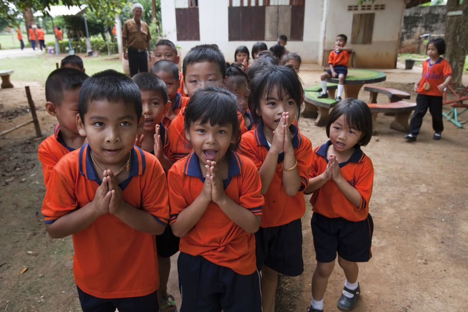 Thai children performing the local greeting known as the