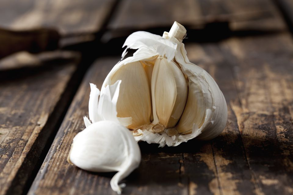 Garlic on dark wood