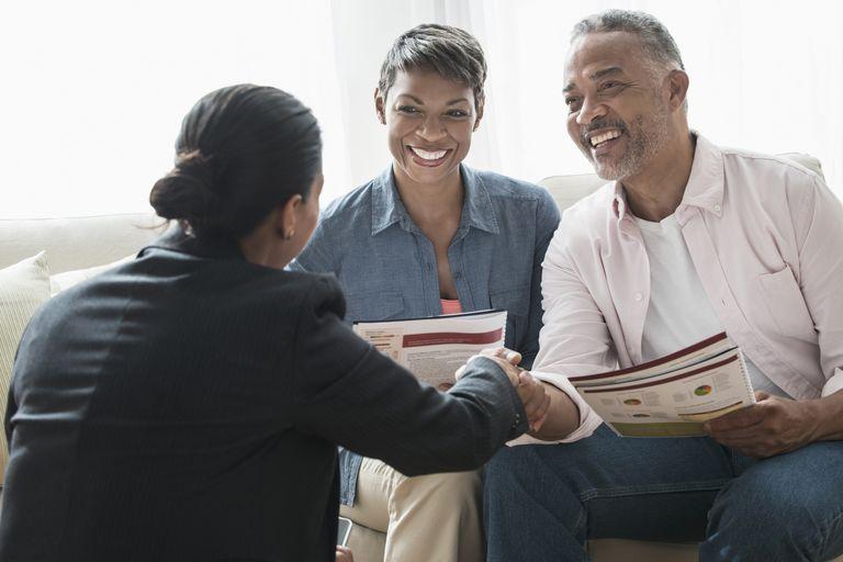 African American couple talking to businesswoman Credit: Jose Luis Pelaez Inc