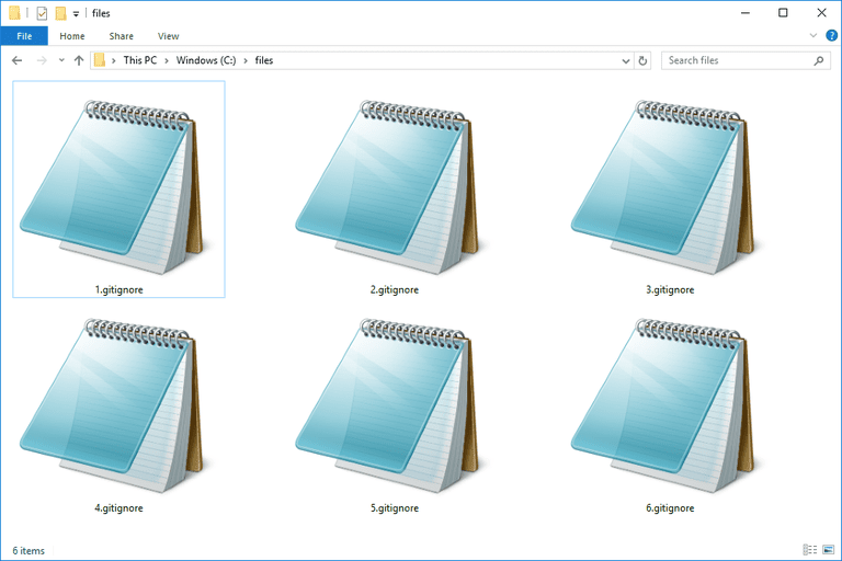Screenshot of several GITIGNORE files in Windows 10 that open with Notepad