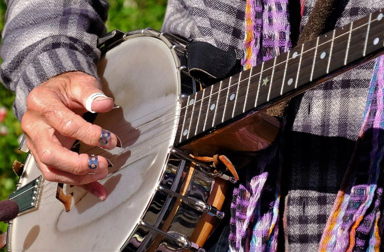 Midsection Of Man Playing Banjo With Fingerpicks