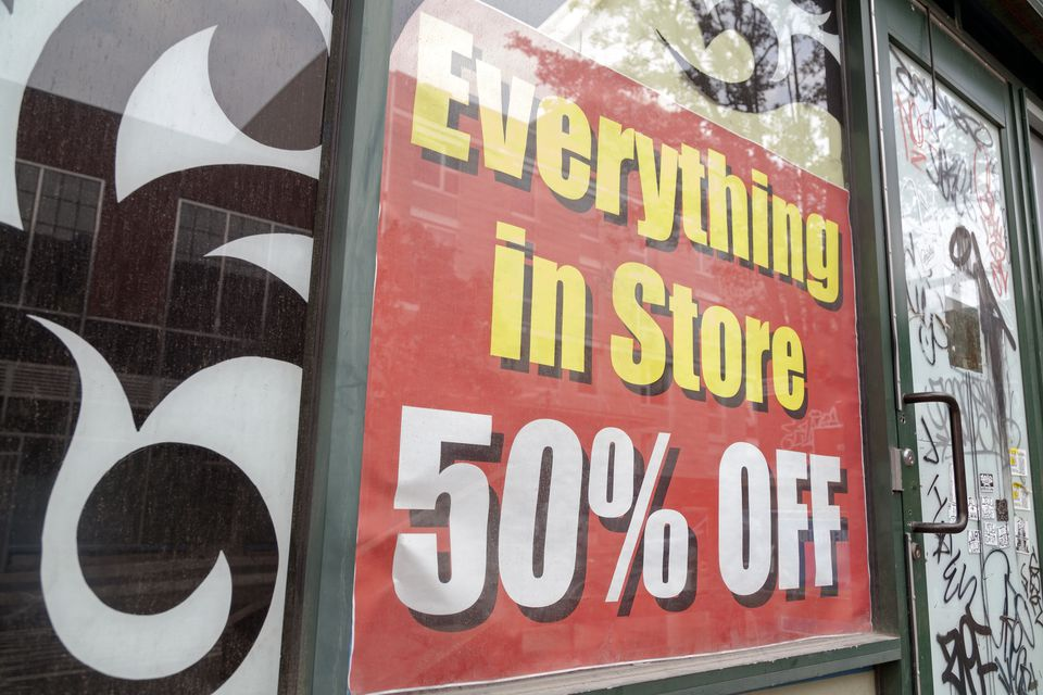 50% off sign in store window