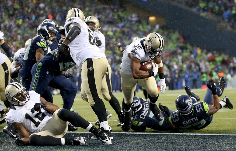 Running back Mark Ingram #22 of the New Orleans Saints scores on a two-point conversion