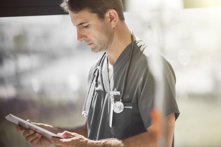 Doctor in hospital ward tablet pc