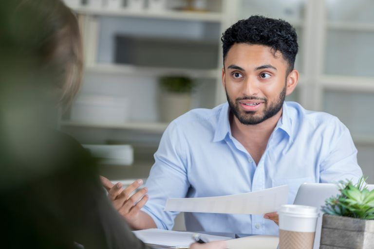 Young manager interviews prospective employee