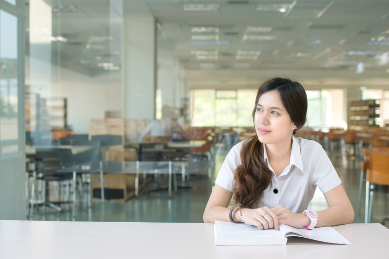 Asian student thinking about something