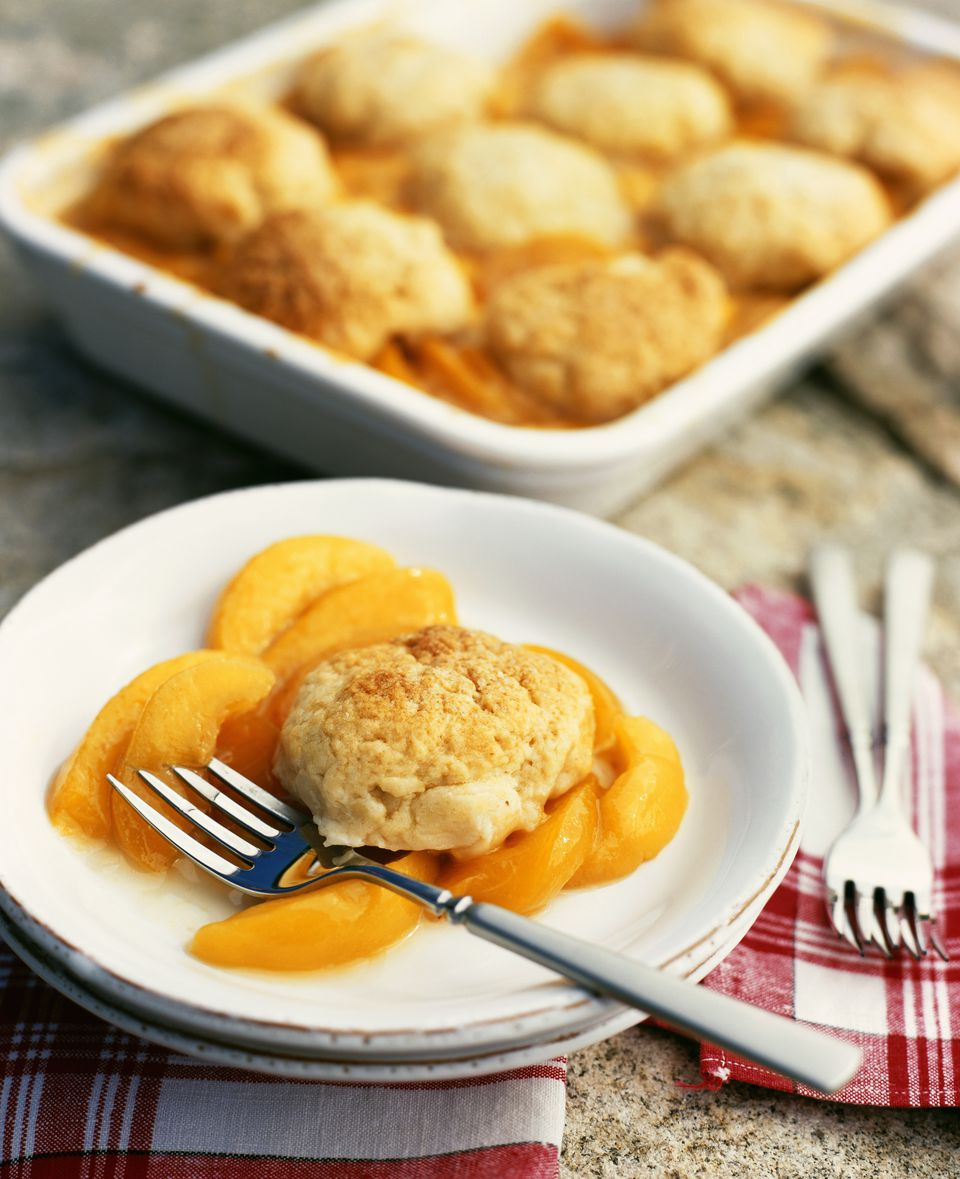 Dish of Peach Cobbler with Single Serving on Plate