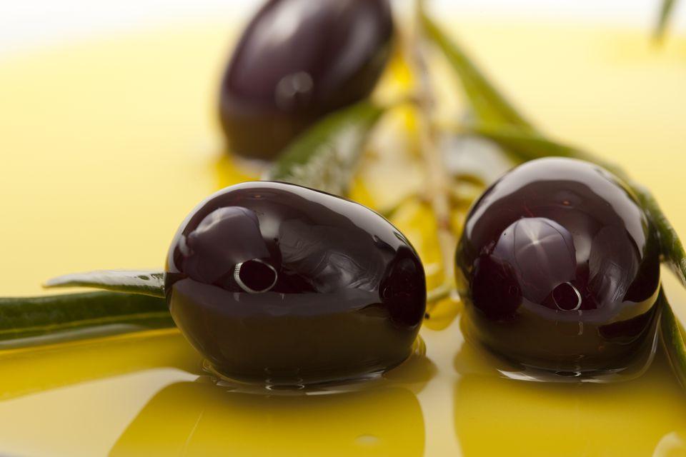 Black Olives in olive oil background