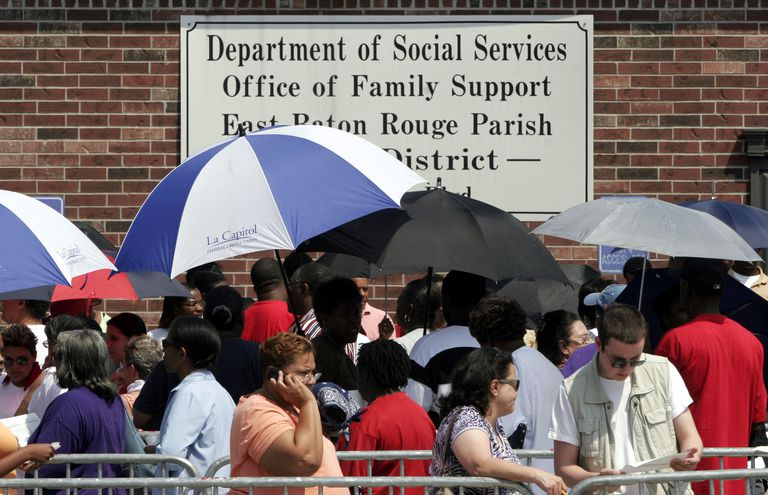 People stand on line to apply for public assistance in Baton Rouge, LA