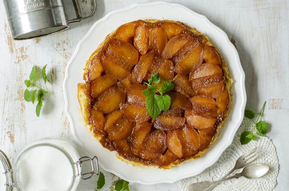 Plate with Tarte Tatin garnished with mint leaves