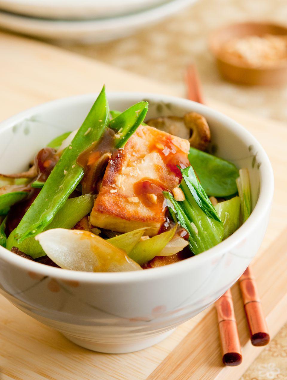 Vegetable stir fry with tofu and chopsticks