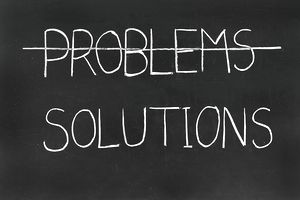 the word problems cross out; the word solutions under it