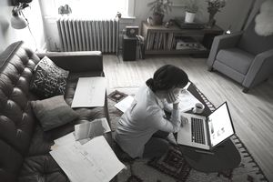 Female architect using laptop in living room