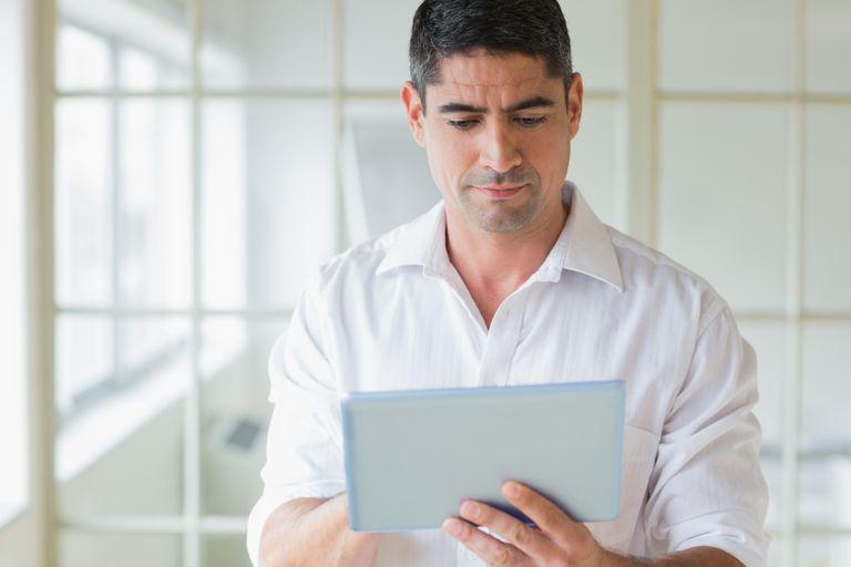 man looking at tablet