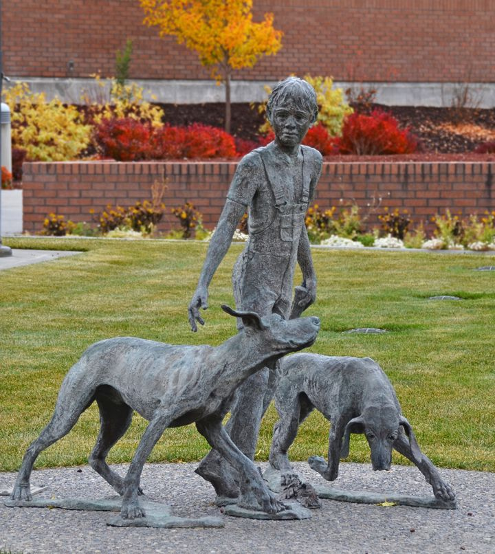 """Statue of characters in """"Where The Red Fern Grows"""" at the Public Library in Idaho Falls, Idaho."""