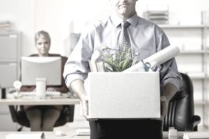 Office worker carrying box of belongings