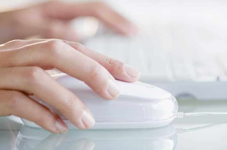 Hands operating computer mouse and keyboard