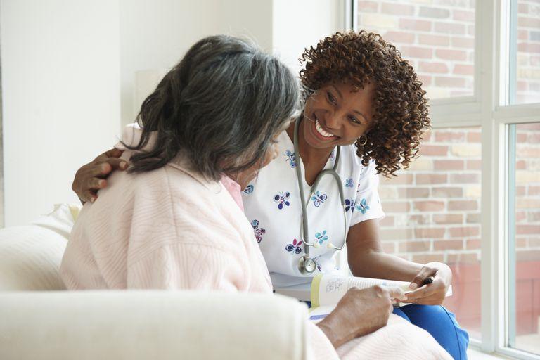Nurse comforting senior woman in hospice