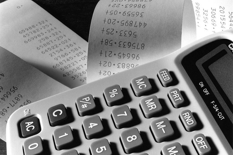 CLOSE-UP / ACCOUNTANCY ADDING MACHINE WITH ROLLS OF DATA