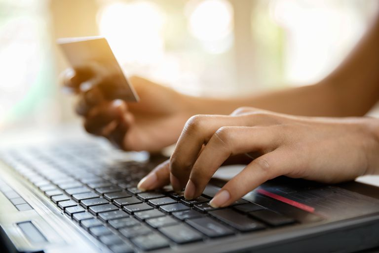 Hands holding credit card and-using laptop online shopping
