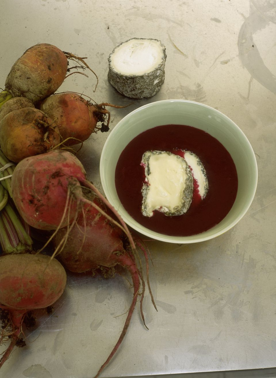 Beetroot soup with slice of ash-dusted goats cheese on top