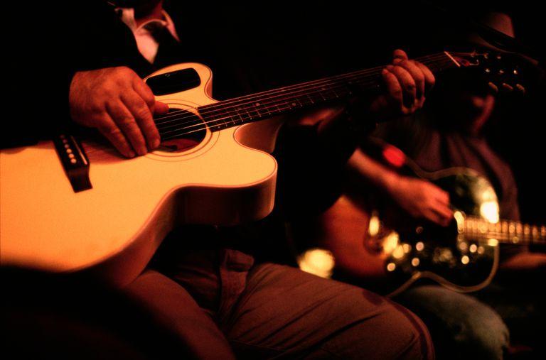 Close-up dark exposure of guitar players.