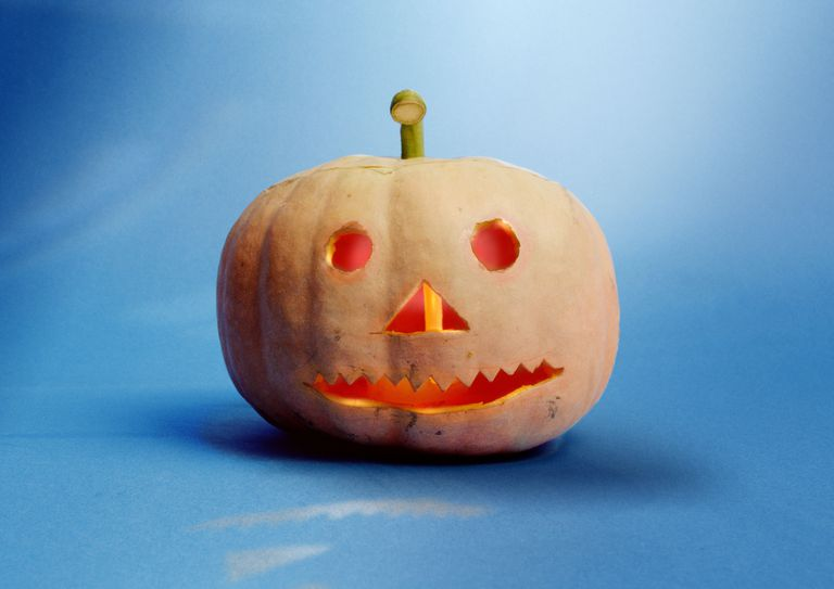 a carved pumpkin on a blue background