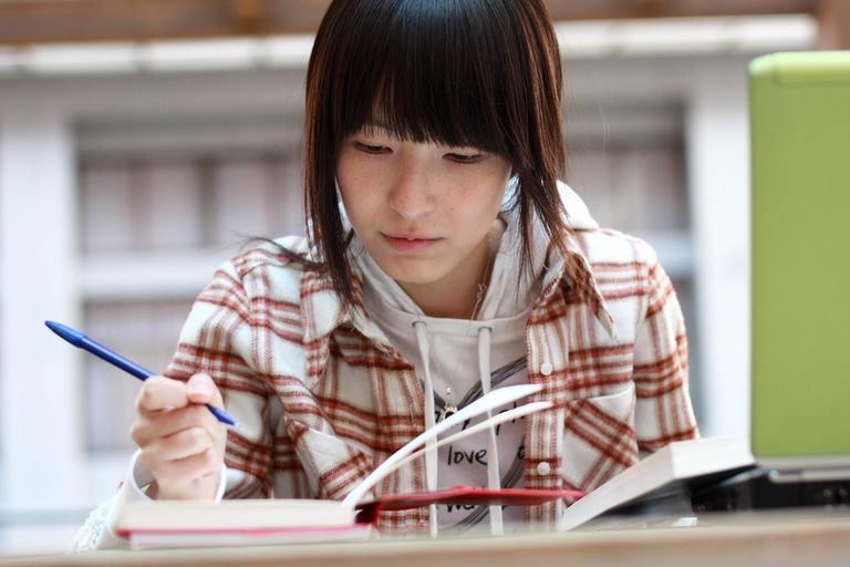 asian student one asian student is doing h...