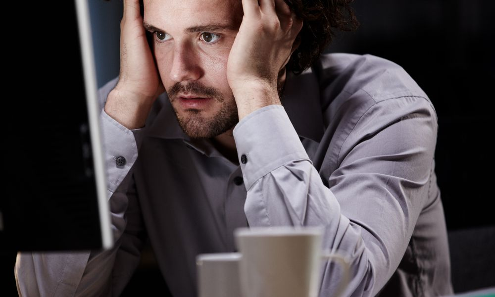 Man Stressed Sitting at Computer
