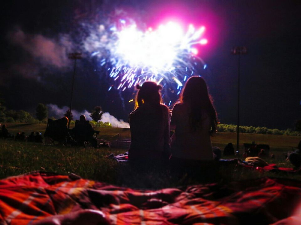 Two women watching fireworks