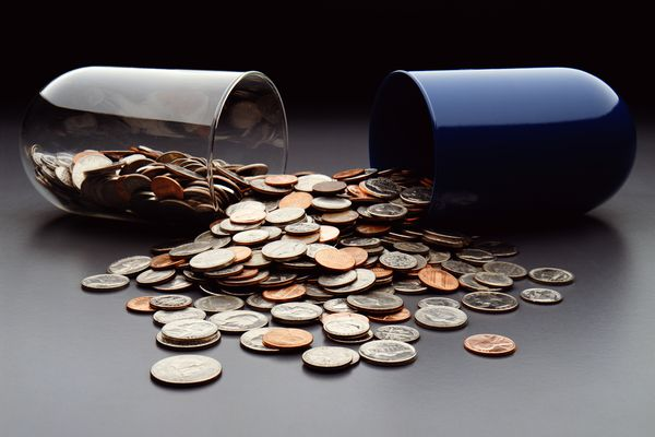 USA coins spilling out of broken capsule