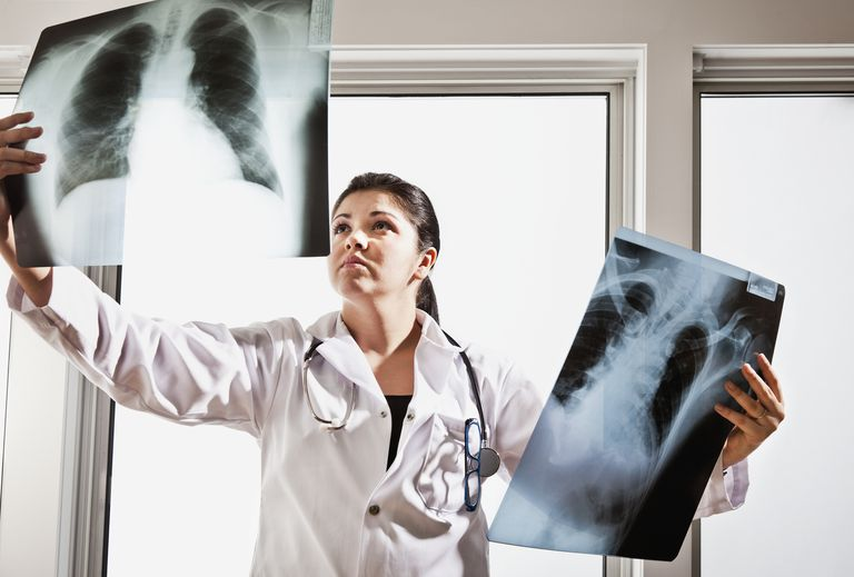 Female hispanic doctor examines chest x-rays
