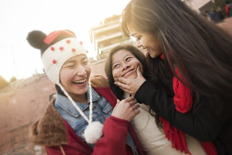 Multi ethnic happy female friends together in outdoor.