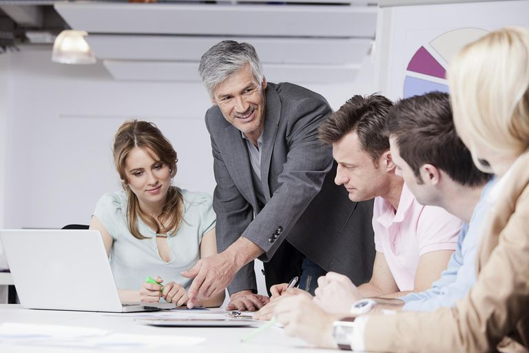 Men and women discussing in office