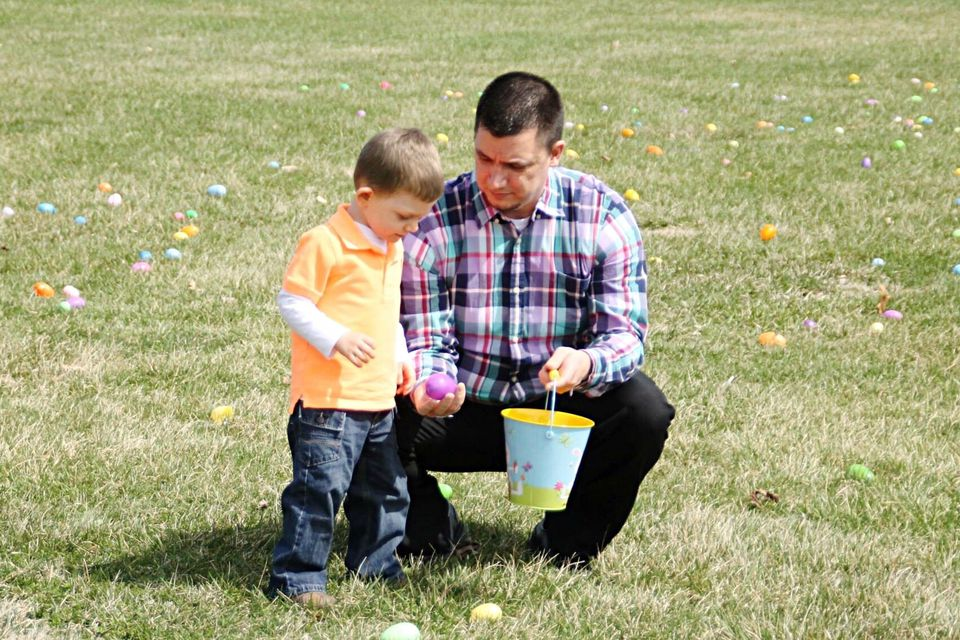Man And Son On An Egg Hunt