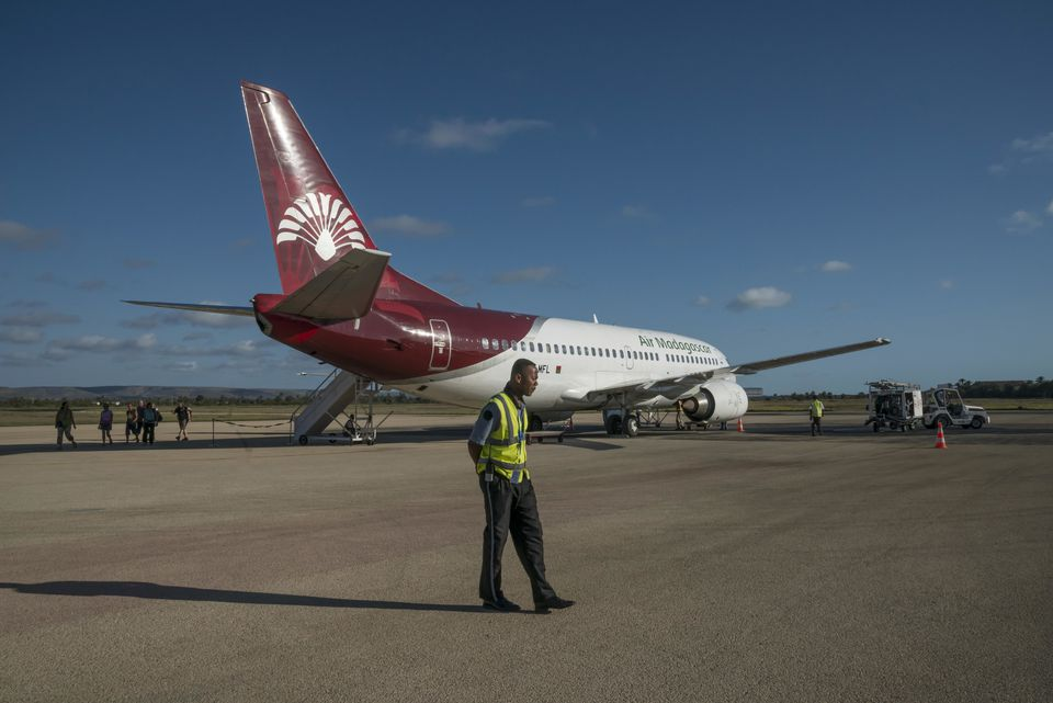 Aircraft, Boeing 737-300, Air Madagascar, on the tarmac at the airport with security personnel, Toliara Province, Tulear, Madagascar, Africa