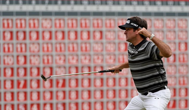 Bubba Watson celebrates his birdie putt and victory on the first play-off hole during the final round of the WGC HSBC Champions in 2014.