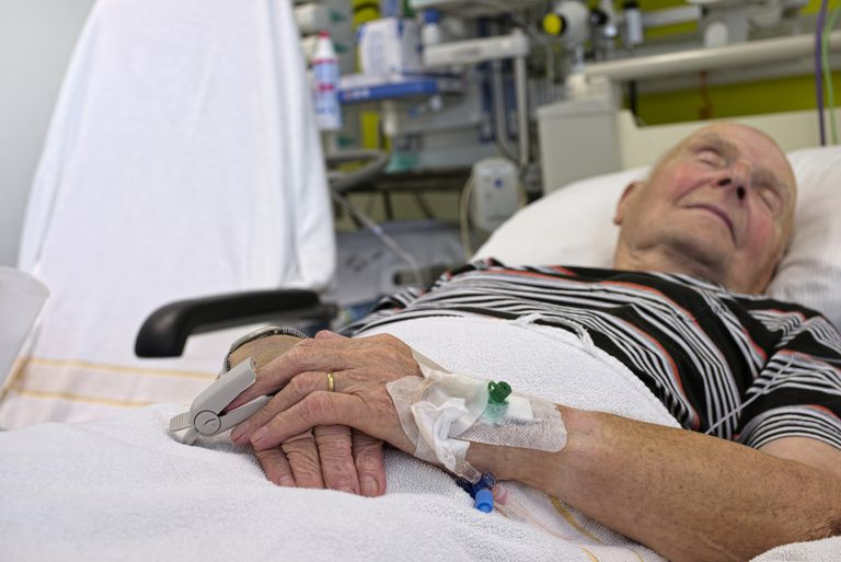 Man sleeping in a hospital bed