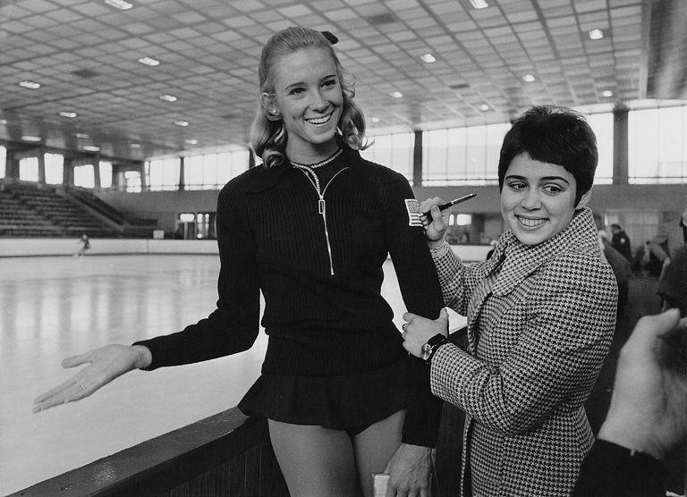 Soviet figure skater Irina Konstantinovna Rodnina (right) signs the badge of American skater JoJo Starbuck at the World Figure Skating Championships in Lyon