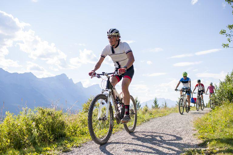 men riding mountain bikes