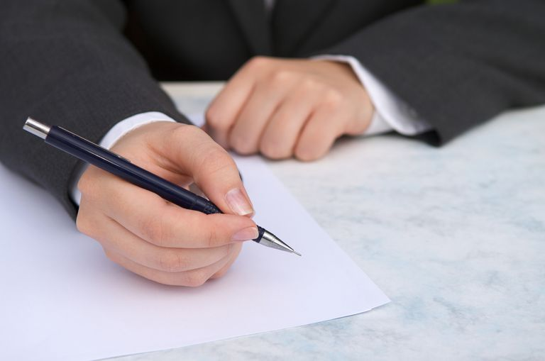 a hand writing a letter