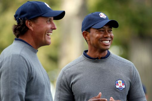 Tiger Woods and Phil Mickelson photographed at the Ryder Cup in 2012. Woods has 14 major wins and Mickelson 5.