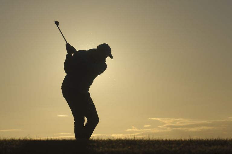 Golfer silhouetted in in Ranzow, Germany
