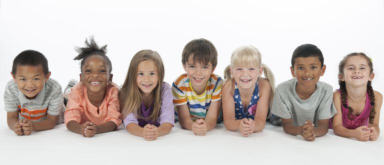 Happy Kids Lying in a Row