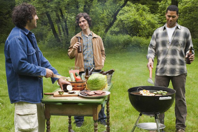 Men barbecuing and preparing food