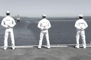 Sailors man the USS Essex