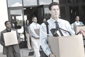 Group of professionals leaving office after layoff or being fired