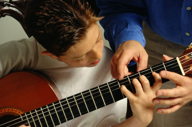 TEACHING YOUNG BOY GUITAR