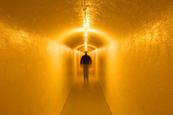 Ghostly Yellow Light in Tunnel